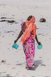 Muslim Woman on the beach. Woman with colorful clothes looking to the sun on the Beach in Zanzibar , Tanzania . Africa Stock Photography