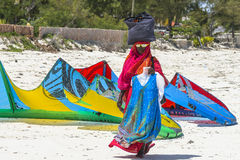 Muslim Woman on the beach. One WomAn with colorful clothes wolking at  Michanwi Pingwe Beach in Zanzibar , Tanzania . Africa Royalty Free Stock Photography