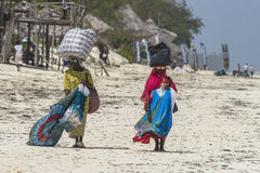 Muslim Woman on the beach. Two Women with colorful clothes wolking at  Michanwi Pingwe Beach in Zanzibar , Tanzania . Africa Stock Photo