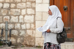 Muslim woman begs on street Stock Photo