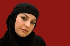 Muslim woman in black Stock Image