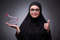 The muslim woman in black dress against dark background Royalty Free Stock Photo