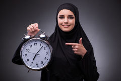 The muslim woman in black dress against dark background Royalty Free Stock Image