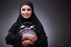 The muslim woman in black dress against dark background Royalty Free Stock Images