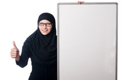 Muslim woman with blank board. On white Stock Photos