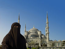 Muslim Woman and Blue Mosque Stock Photography