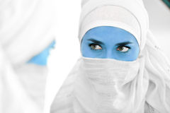 Muslim woman with blue skin. As alien looking at mirror, conceptual image stock image