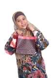 Muslim woman with brightly colored shopping bags Royalty Free Stock Images