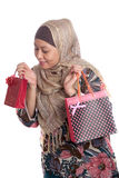 Muslim woman with brightly colored shopping bags Royalty Free Stock Image