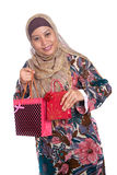 Muslim woman with brightly colored shopping bags Royalty Free Stock Photo