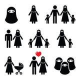 Muslim woman in burqa or burkha, bourkha, burka - family Stock Images