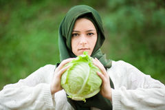 Muslim Woman with Cabbage Stock Images