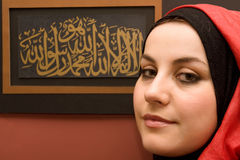 Muslim woman and calligraphy Royalty Free Stock Image