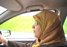 An a muslim woman in car Stock Image