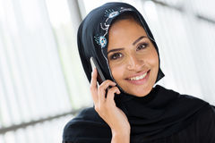 Muslim woman cell phone. Cheerful modern muslim woman talking on cell phone Stock Photography