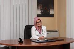 Muslim Woman Doctor Having Short Break Stock Photo