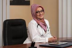 Muslim Woman Doctor Having Short Break Stock Photos