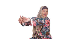 Muslim woman doing arm stretching exercise Stock Images