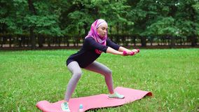 Muslim woman doing her best to keep fit stock video