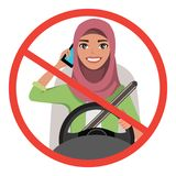 Muslim woman driving a car talking on the phone. Muslim woman wearing hijab. sign stop danger. Muslim woman driving a car talking on the phone. Muslim woman Stock Photography