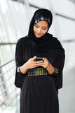 Muslim woman email. Modern muslim woman reading email no smart phone Royalty Free Stock Images
