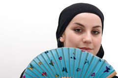 Muslim woman with fan Royalty Free Stock Photo