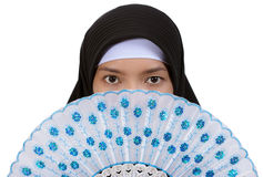 Muslim woman with fan Stock Images