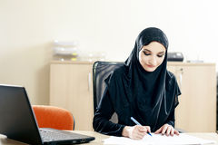 Muslim woman fills the documents Stock Photography