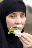 Muslim woman and flower Stock Photography