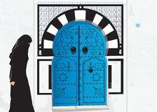 Muslim woman front Tunisian door Stock Photo