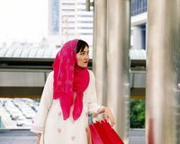 Muslim woman goes shopping in city Royalty Free Stock Photo