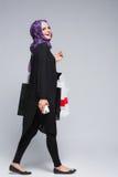 Muslim woman goes shopping Royalty Free Stock Photo