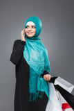Muslim woman goes shopping Royalty Free Stock Images