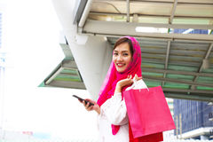 Muslim woman goes shopping in the mall Stock Photo