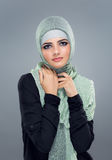 Muslim woman goes shopping Stock Images