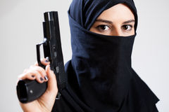 Muslim woman with a gun Royalty Free Stock Image