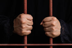 Muslim woman hand in jail Royalty Free Stock Images