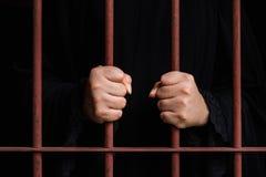 Muslim woman hand in jail Stock Image