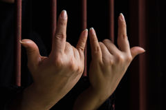 Muslim woman hand in jail Stock Photo