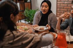 Muslim woman having dinner together royalty free stock photography