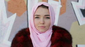 Muslim woman with her head covered with pink scarf . Full hd video stock video footage