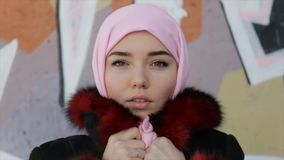 Muslim woman with her head covered with pink scarf . Full hd video stock footage
