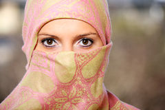 Muslim woman hidden behind a scarf Royalty Free Stock Images