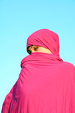 Muslim woman hiding behind scarf Royalty Free Stock Photos
