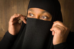 Muslim woman hiding behind veil Stock Photos