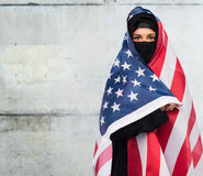 Muslim woman in hijab with american flag Royalty Free Stock Images