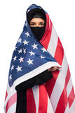 Muslim woman in hijab with american flag Stock Images
