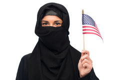 Muslim woman in hijab with american flag Royalty Free Stock Photos