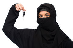 Muslim woman in hijab with car key over white Stock Images