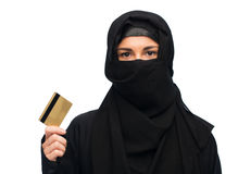 Muslim woman in hijab with credit card over white Stock Photography